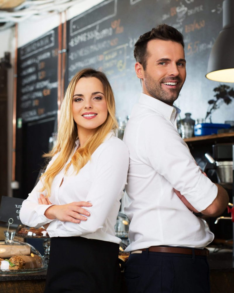 Small,Business,Partners,Standing,Together,At,Their,Coffee,Shop,,Cafe